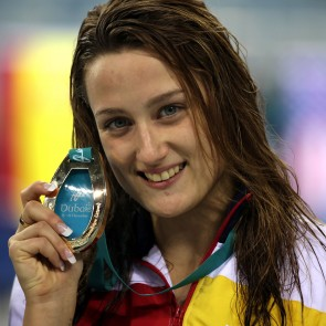Spanish swimmer Mireia Belmonte holds her gold medal on the podium during the medal ceremony for the women's 200m individual medley at 10th FINA World Short Course Swimming Championship in Dubai on December 18, 2010. AFP PHOTO/PATRICK BAZ